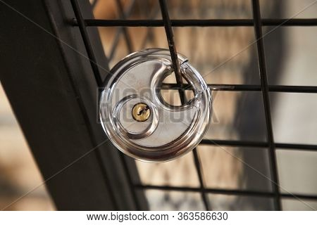 Metal fence with a padlock attached to it