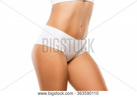 Beautiful Female Legs, Buttlocks And Belly Isolated On White Background. Beauty, Cosmetics, Spa, Dep