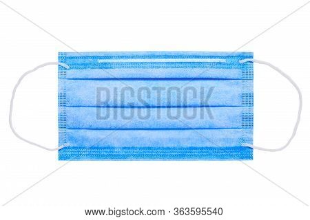 Blue Medical Facial Mask Isolated On A White Background. Doctor Concept. Medical Topics. Medical Bac