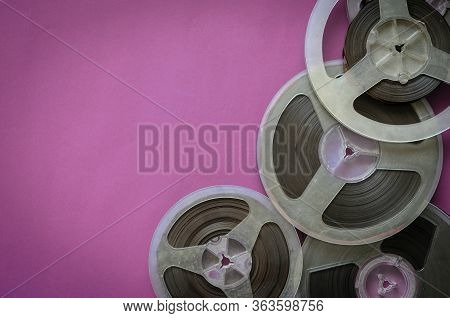 Reels With Magnetic Tape On A Colored Background. Random Bobbins With 60s Audio Recordings. Nostalgi