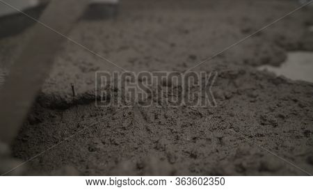 A Professional Worker Is Laying The Floor. Laying Concrete Floor With Mortar. Laying Mortar On The F