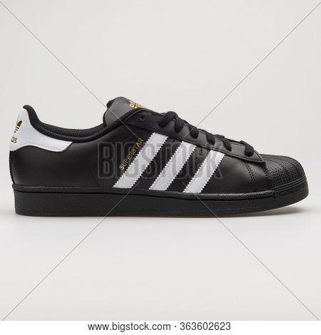 Vienna, Austria - February 19, 2018: Adidas Superstar Foundation Black And White Sneaker On White Ba