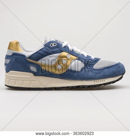 Vienna, Austria - February 19, 2018: Saucony Shadow 5000 Vintage Blue, Gold And Grey Sneaker On Whit