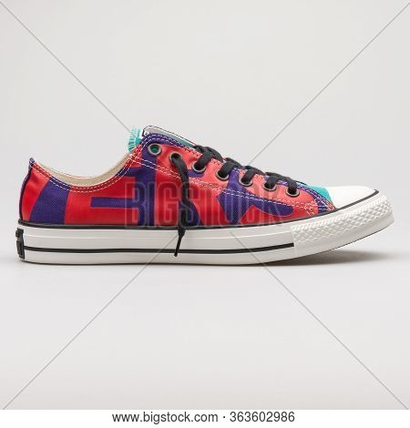 Vienna, Austria - February 19, 2018: Converse Chuck Taylor All Star Ox Purple, Red And Cyan Sneaker