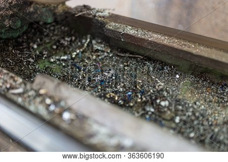 A Part Of The Old Lathe Machine With Metal Shavings. Lathe For Metal Processing. Screw Turning Machi