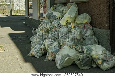 Goeppingen,germany - April 11,2020;ulmer Strasse This Are Many Yellowish Trash Bags, Wich Are Called