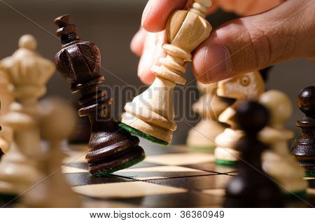 playing wooden chess pieces