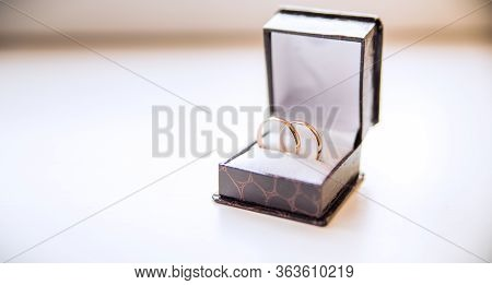 Gold Wedding Rings In A Box. The Concept Of Marriage Registration, Love, Fidelity And Joint Life. Ri