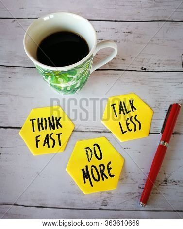 Three sticky notes with short reminder, think fast, talk less and do more