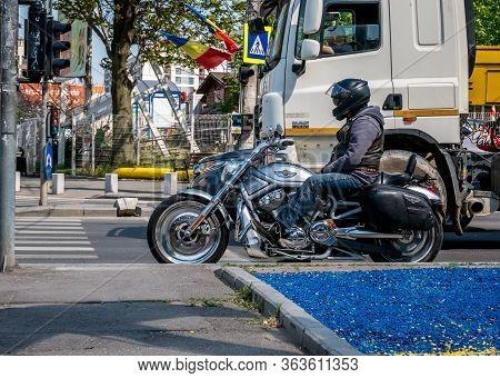 Bucharest/romania - 04.27.2020: Biker On A Harley-davidson Motocycle Waitting At The Traffic Light