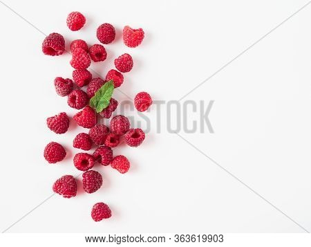 Heap Of Fresh Ripe Red Raspberries With Green Leaf On White Background. Raspberry With Copy Space Fo