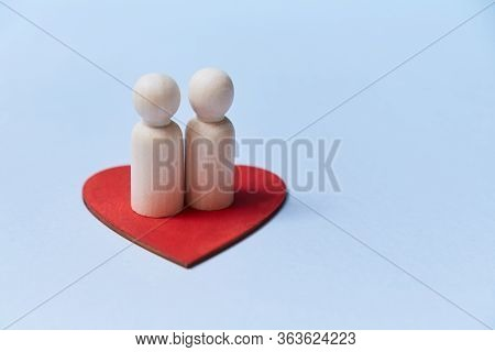Happy Family. Adopt Kid. Relationship Between Mum And Dad. Wooden Figures On Red Heart. Copy Space.