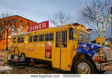 Liverpool, Uk : Mar 16, 2019: An American Style Yellow School Bus Is Used As A Diner Restaurant At T