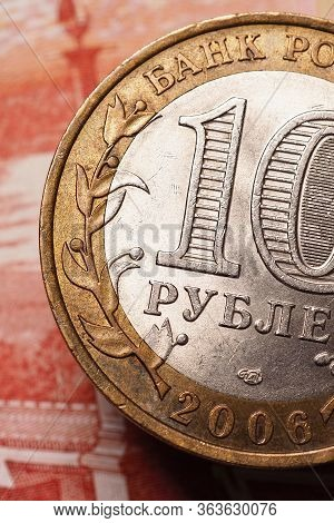 A 10-ruble Bimetallic Russian Coin Hangs Above A 5000 Note. Banks, Microfinance And Microcredit Orga