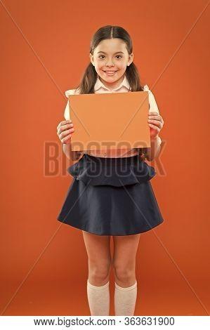 Little Schoolgirl. Happy Girl Wear School Uniform. Back To School Concept. Schoolgirl Smiling Pupil