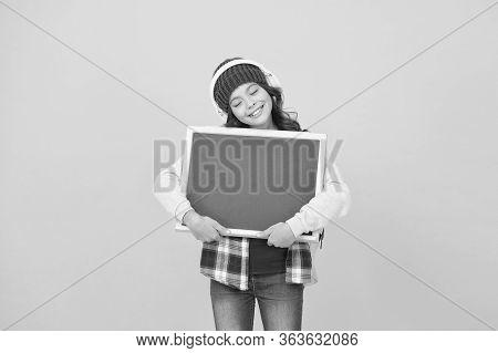 Girl Cute Little Child Wear Headphones Listen Music Hold Chalkboard Copy Space. Small Kid Listen Mus