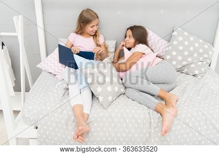 Read To Me. Little Girl Read Story To Sister. Small Kids Read Before Bed. Literature And Library. Ch