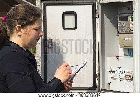 Minsk. Belarus. April 28, 2020. A Peasant Girl Will Check And Record The Reading Of The Electricity