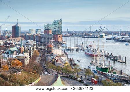 Hamburg, Germany - November 26, 2018: Port Of Hamburg With Moored Ships At Daytime, Ordinary People