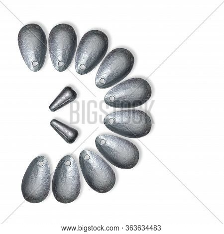 The Set Of Lead Fishing Sinkers Is In Semicircle And Isolated On The White Background.