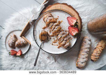 Walnut Plaits With Cinnamon And Caramel Sauce