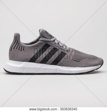Vienna, Austria - February 19, 2018: Adidas Swift Run Grey, Black And White Sneaker On White Backgro