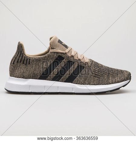 Vienna, Austria - February 19, 2018: Adidas Swift Run Khaki And Black Sneaker On White Background.