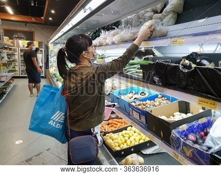 Gold Coast, Australia - April 29, 2020: Asian Female Wears Protective Medical Mask In Asian Grocery