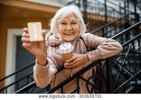 Happy Seniour Lady With Coffee Outdoors Stock Photo