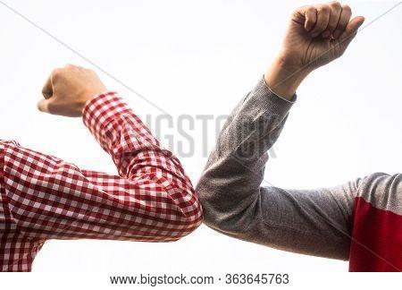 Friends Shaking Elbows Outdoors. Coronavirus Epidemic. Closeup Elbow Bump. Couple Greeting With Elbo