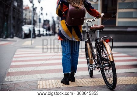 Female Cycler On The Zebra Crossing Stock Photo