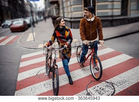 Friendly Cyclers Walking On Zebra Crossing And Talking