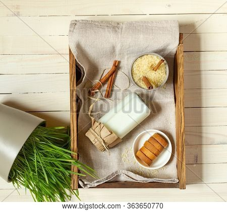 Rice Milk In A Bottle And A Saucer With Crackers On A Wooden Tray, Top View, Light Wooden Background