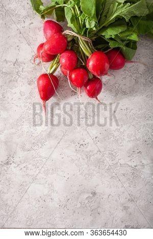fresh raw radish on gray background