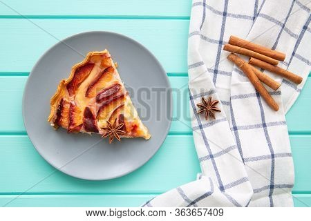 A Piece Of Tasty Fruit Cake On Turquoise Wooden Table, Top View.
