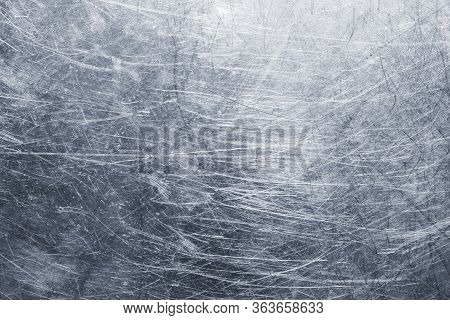Background Metal Sheet With Scratches On The Surface, Steel Texture Or Aluminum With Chrome Gloss