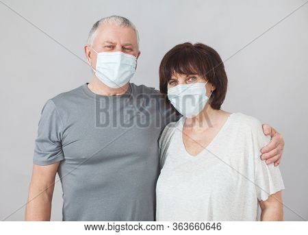 Couple of elderly people in medical masks. Mature man and woman in the period of the pandemic and quarantine coronavirus Studio shot