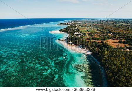 Aerial Photography Of The East Coast Of The Island Of Mauritius. Flying Over The Turquoise Lagoon Of