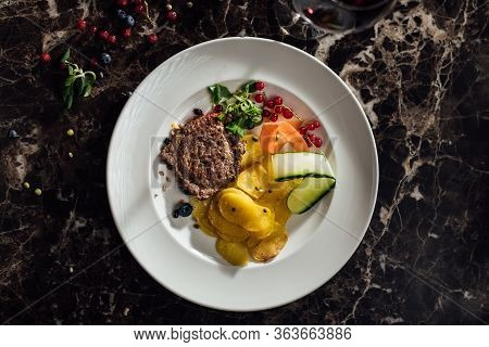 Homemade Beef Steak Served Over Thin Baked Potatoes.small Portion.portion Control.restaurant Recipe