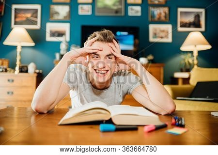 Smiling Man Studying From Home.bored Student Studying For Exams.student Having Online Distance Learn