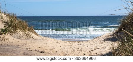 Looking Through The Dunes At The Atlantic Ocean On A Sand Footpath In Montauk New York Long Island U