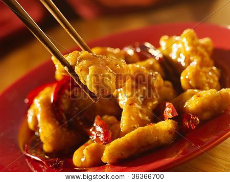 Chinese food - General Tso's chicken with chopsticks.