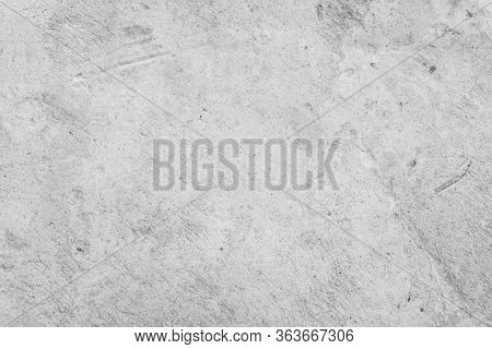 Grunge Concrete Wall At Covered With Gray Cement Loft Old Surface With Crack In Industrial Building,