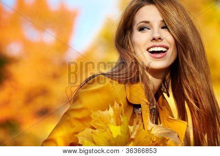young brunette woman portrait in autumn color