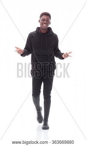 cheerful guy in autumn jacket striding forward