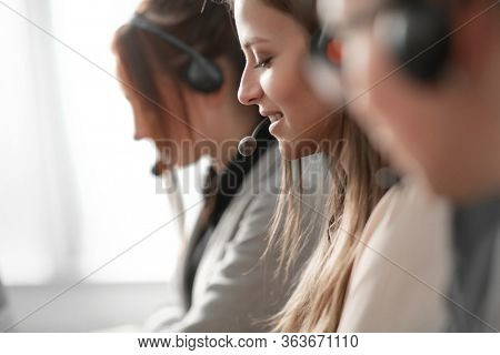 close up. the female operator communicates with the client