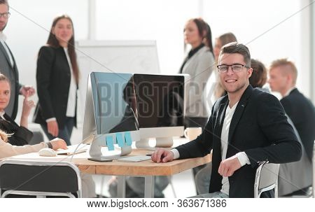 image of a successful business man sitting at his Desk