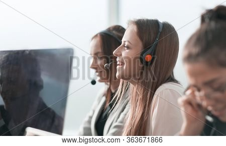 smiling call center operator sitting at his Desk