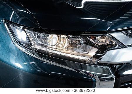 Beauty Clean Headlights Of  Blue Suv. Close Up  Of Modern  Car Xenon Lamp Headlight