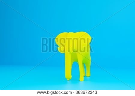 Full Sized Yellow Smooth Elephant On A Blue Isolated Background. 3d  Rendering Model Of An Elephant